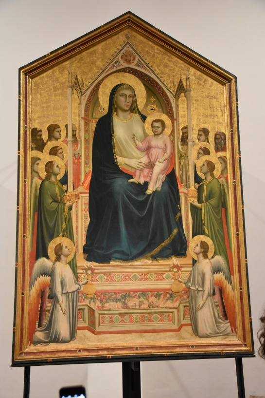 Madonna and child enthroned with angels and saints